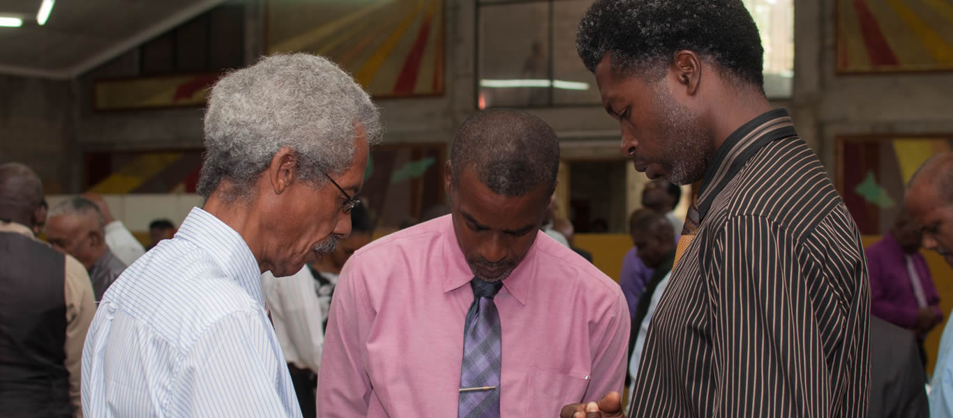 <strong>Elders in prayer</strong>  	       <br/>Church elders in prayer at recent  Elders Seminar